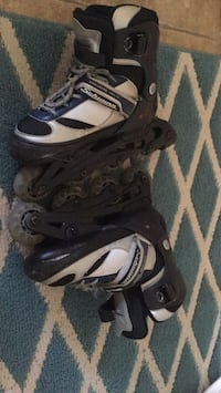 pair of black-and-white inline skates North Dumfries