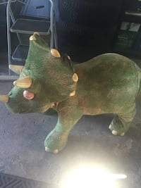 Green triceratops plastic toy