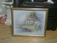 cabin beside body of water framed painting