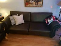 Brown leather sofa with pillows and puff Montreal, H1C 2B4