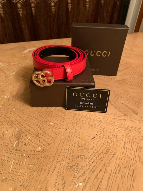 Red Gucci woman belt with gold buckle