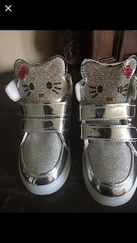 Brand new lighting shoes hello kitty size toddlers 9 to 10 can fit easily.  Brampton, L7A