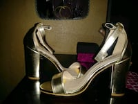 pair of women's gold-and-white pumps Houston, 77039