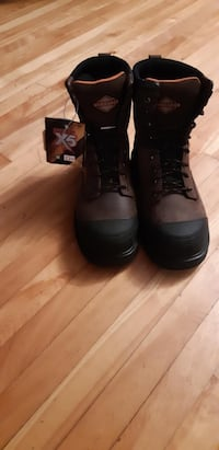 pair of black leather boots Laval, H7W 4G8