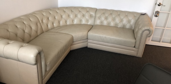 Tufted beige leather sectional sofa