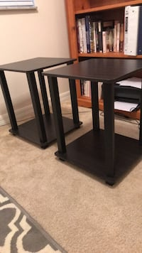 two black wooden side tables