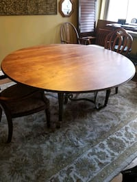 "Stunning dining room table 5' 6"" wide. Elegant metal base. Seats 6!"