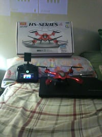 red and black HS-Series quadcopter with box 50 mi