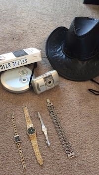 black leather cowboy hat; grey film camera; four pieces silver-colored watches Merced, 95348