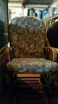 brown wooden framed gray floral padded glider chair Staples, 56479
