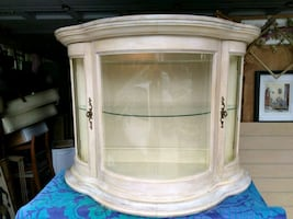 Elegant Bow Front Glass Cabinet Display