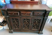 brown wooden 2-door cabinet