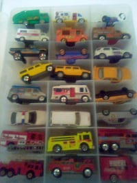 50 mixed toy cars and trucks in carrying case