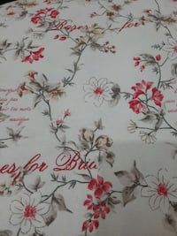 white red and gray floral textile
