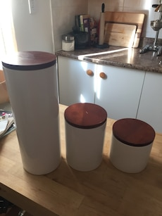 3 ceramic storage containers with wood tops