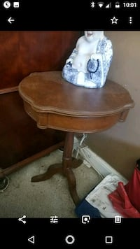 brown wooden pedestal table with white ceramic vase North Miami, 33181