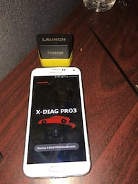 white Samsung Galaxy smartphone with X-DIAG automotive scan program with 50 cars to choose from