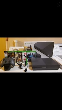 black Xbox One console with controller and game cases Allentown, 18102