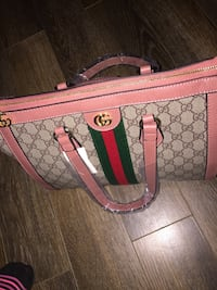 Brown and pink Gucci purse Halifax, B3R 1R3