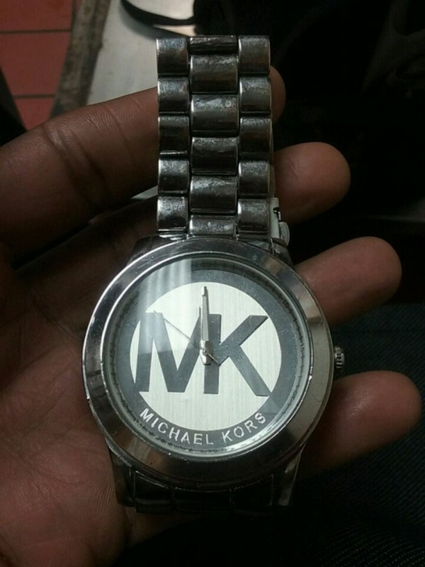 round silver Michael Kors analog watch with silver