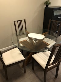 rectangular brown wooden table with four chairs dining set Vancouver, V6J