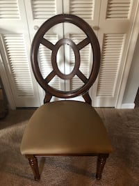 Round brown wooden table with four chairs dining set South Windsor, 06074
