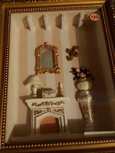 brown wooden framed fireplace and mirror ornament