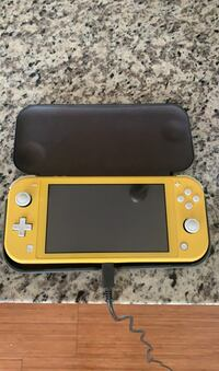 Nintendo Switch Lite with Cover and Pre Loaded Games