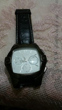 round silver chronograph watch with black leather