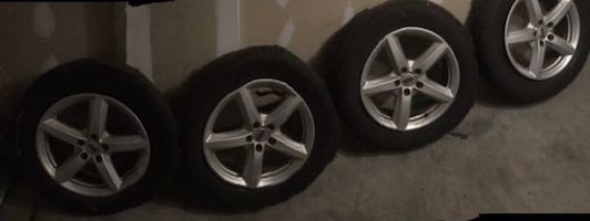 4 Michelin P245/60 R18 tires with Ford rims