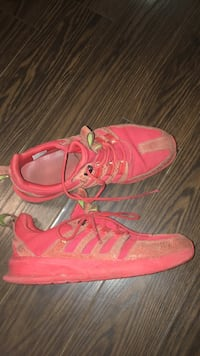 Pair of red running shoes Mississauga, L5M 6E6