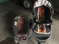 Baby's black jogging stroller and car seat carrier used one time Laval