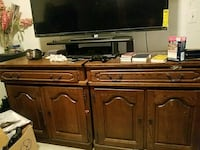 black flat screen TV with brown wooden TV stand 17 mi