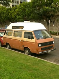 white and brown Ford Transit van