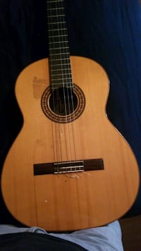 beat up nylon string guitar. sounds good still just was my first one