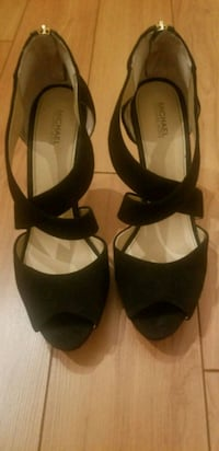 pair of black leather open-toe heeled sandals Calgary, T3A 0E2