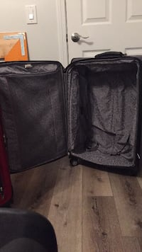 Two (2) Large Luggage Suitcases FERNANDINA