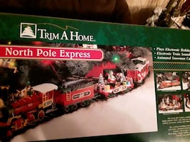 Trim a Home Christmas Train,  vintage. Plays music and characters move