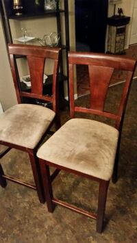 two brown wooden framed beige padded chairs Longueuil, J4K 2W6