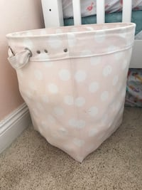 white and pink polka dot diaper changing table