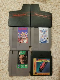 4 Nintendo Games, Plus 2 Dust Sleeves.  Smithtown