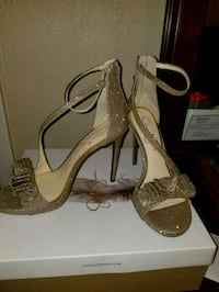 pair of brown leather open toe ankle strap heels Shreveport