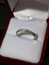 14k WG 0.25ctw diamond chennel set band.  Vancouver, V5R 4B5