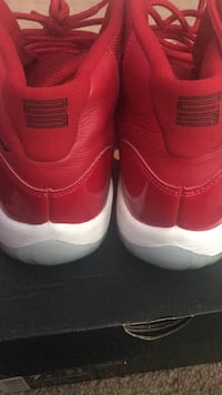 pair of red Air Jordan 11's Washington