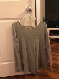 Grey long sleeve with top back showing from garage