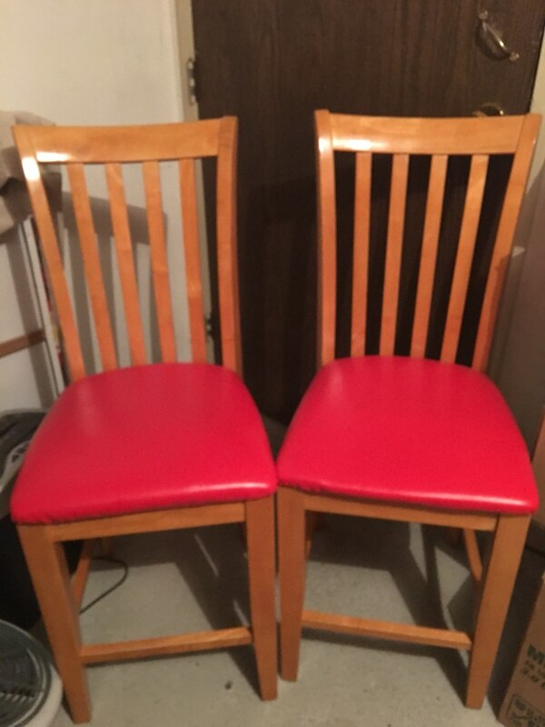 Red leatherette  padded parson chairs with brown wooden frames 3453d098-ae23-4819-a805-3429acab6e6b