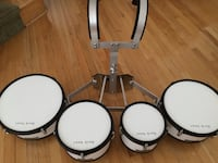 White and black tenor drums 3 km
