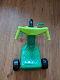 Green plastic on tricycle