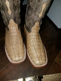 pair of brown leather cowboy boots Houston, 77093