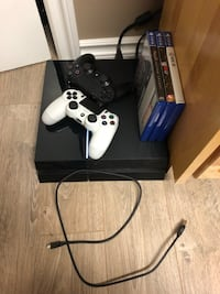 Black sony ps4 console with controller and game cases Winnipeg, R3R 2M2